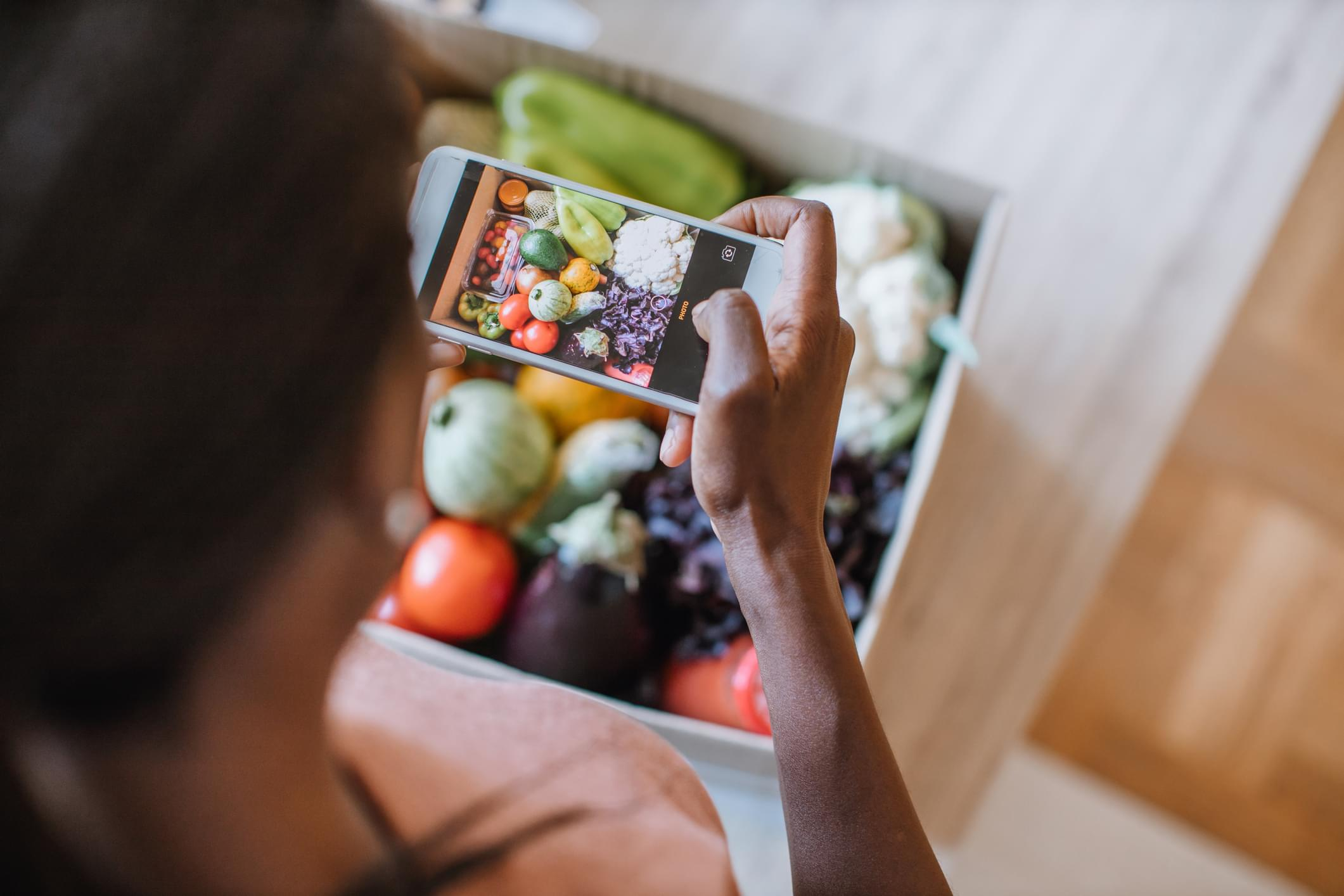 Woman Photographing Groceries In Meal Kit