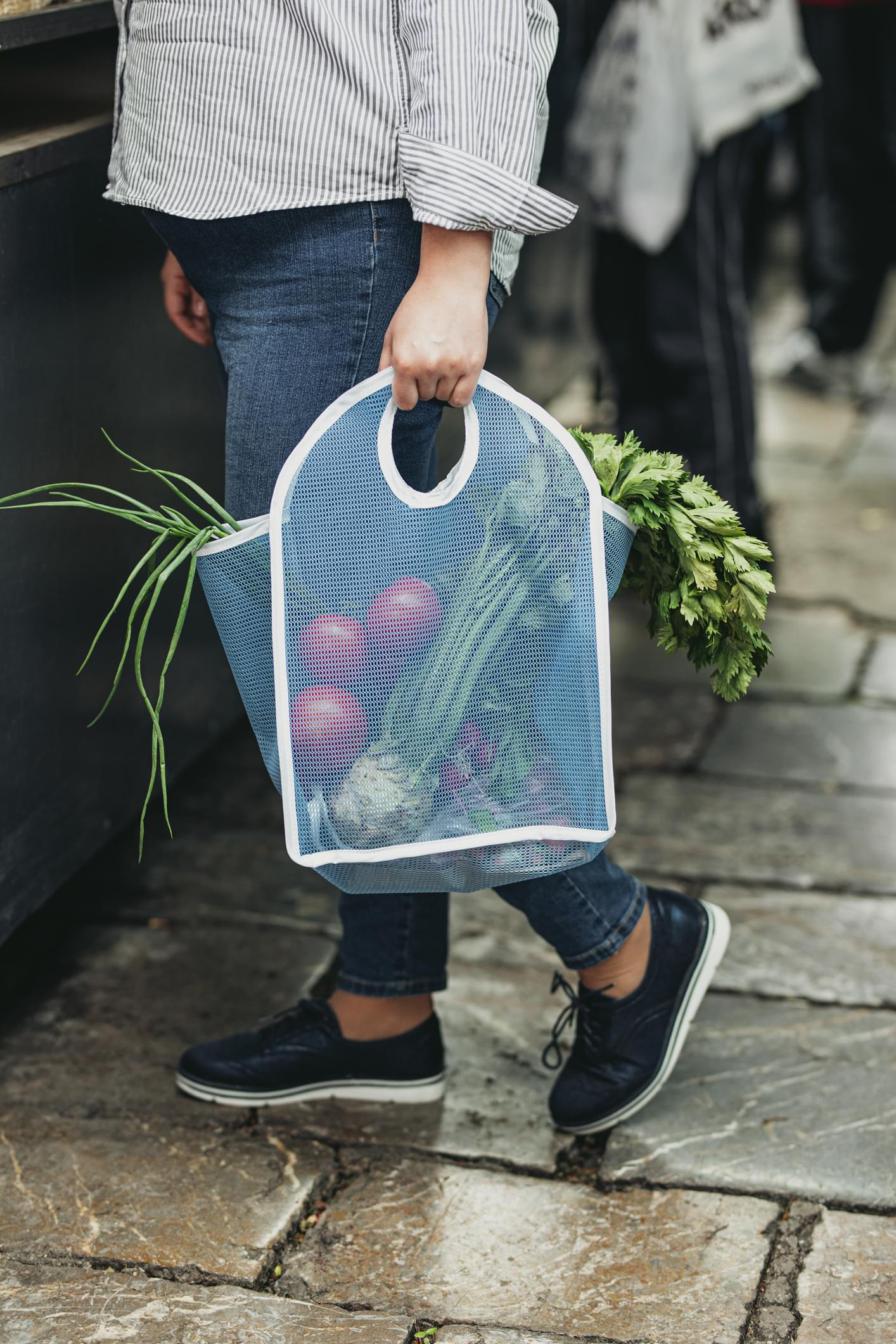 Buying Locally Sourced, Organic Fruit and Vegetables: an Anoymous Woman Holding a Bag Full of Food