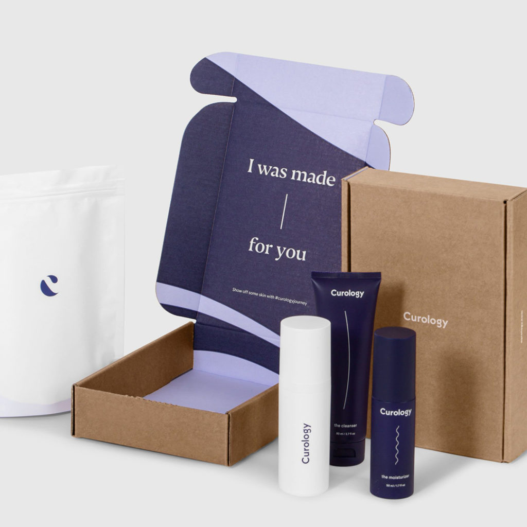 purple and brown men's skin care prodcuts and packaging