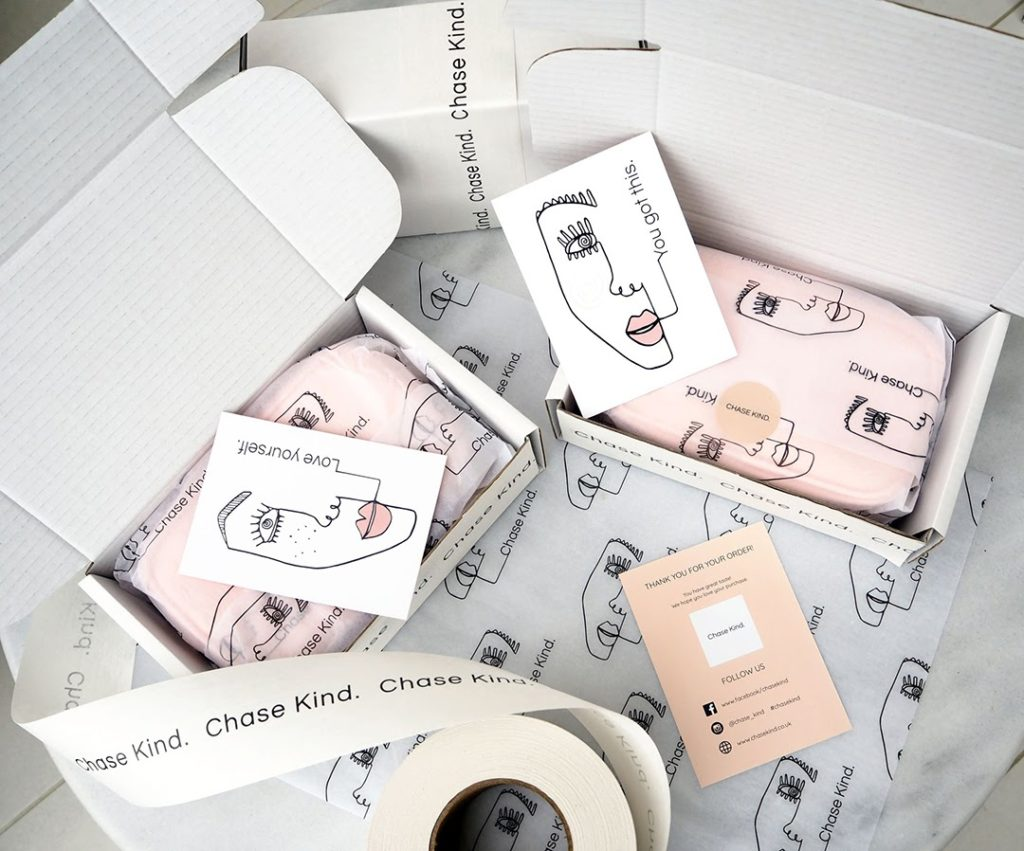 cosmetic packaging and cards with faces on them