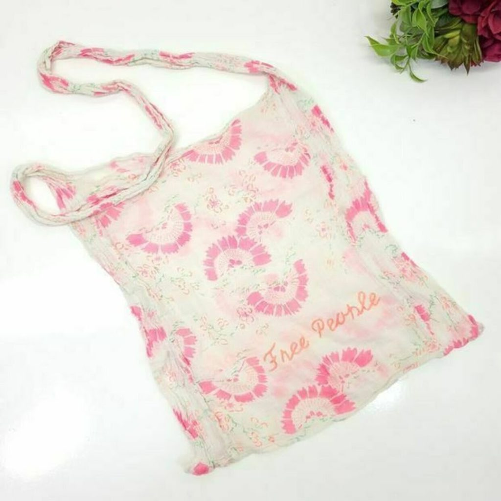 pink and white reusable bag