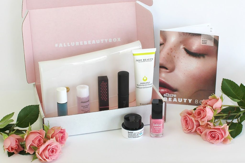 beauty products in pink and white packaging