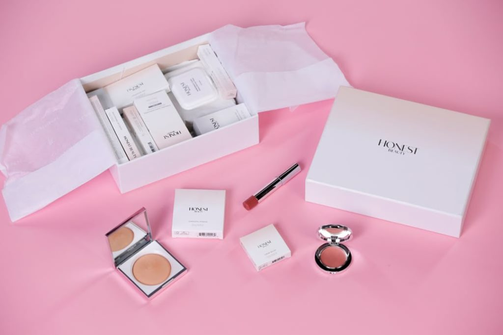 white beauty products on pink background