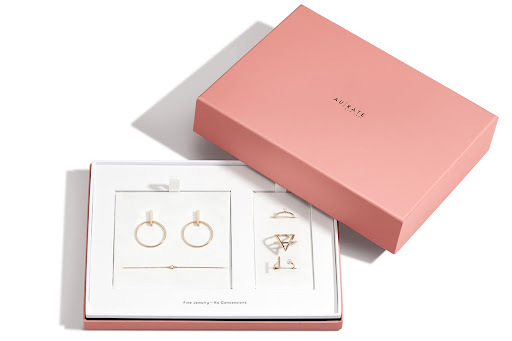 pink and white Aurate jewelry packaging